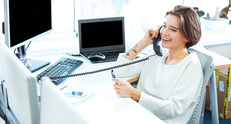 Happy Businesswoman Working at Clean Desk
