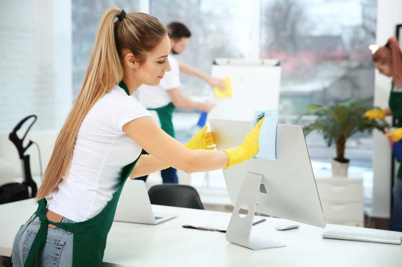 Young Woman Professionally Cleaning Office