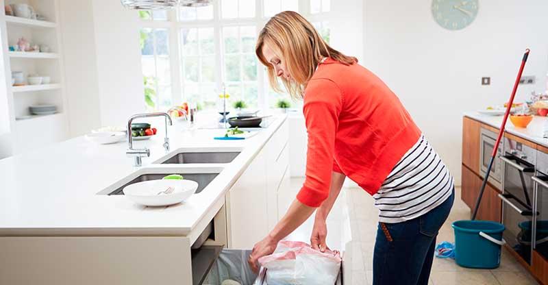 Woman Emptying the Kitchen Bin