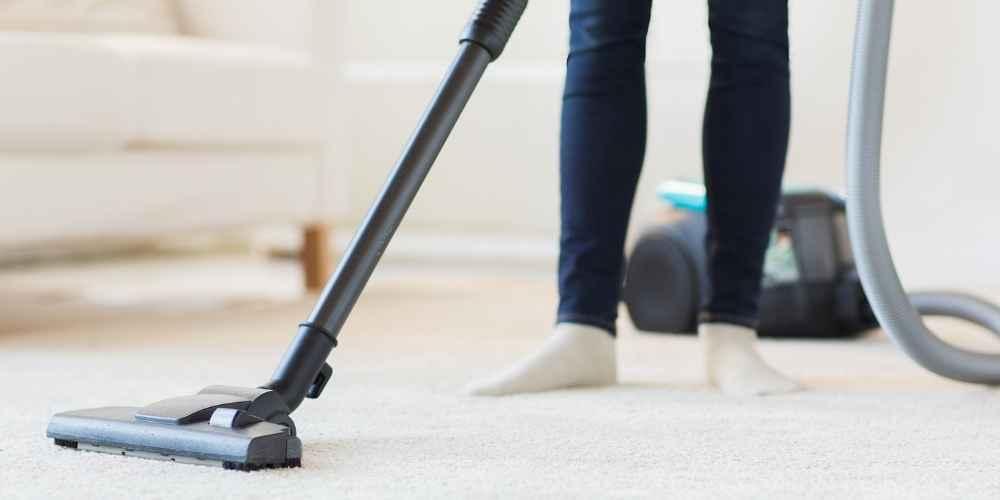 Vacuum Carpeting to Remove Dust